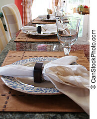 Place Setting - Three place settings on a marble countertop