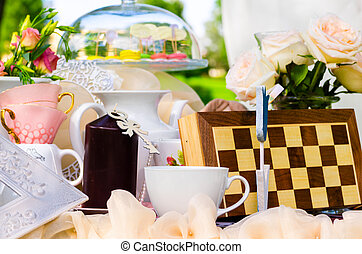tea party in park, alice in wonderland style