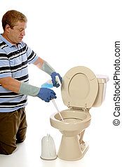 Toilet Cleaning - A man cleaning a residential toilet...