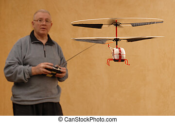 Senior Heli Pilot - Senior man piloting a radio controlled...