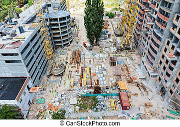 Construction site with many equipment and building garbage