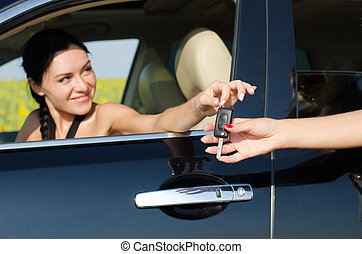 Smiling driver holding her car key
