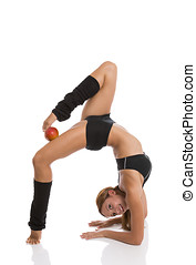 Flexible woman with red apple - Flexible fitness woman...