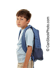 Back to school - A young boy returns to school after the...