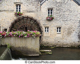 A water wheel in Bayeux, Normandy, France