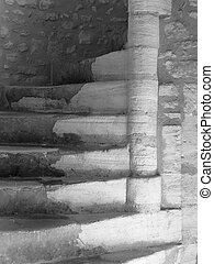 Ancient stairwell - A BW photo of a stone spiral stairwell...