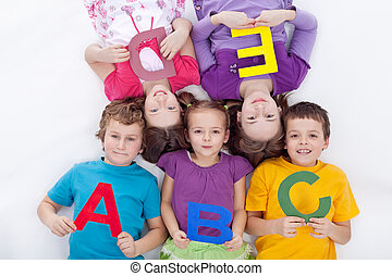 Group of kids holding alphabetical letters - back to school...