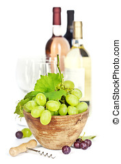 Wine testing - Fresh grape in bowl and wine isolated on...
