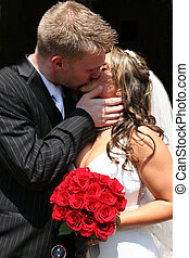 Bride and Groom Kissing - Young beautiful and handsome bride...