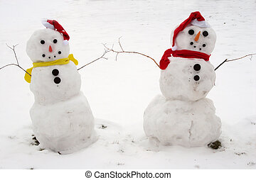 Snowmen Couple - Portrait of two snowmen - a cute couple