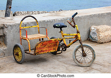 Children's tricycle - Vintage tricycle in the streets of...