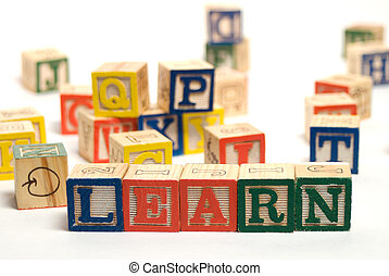 Learn - The word learn spelled using wooden baby blocks,...