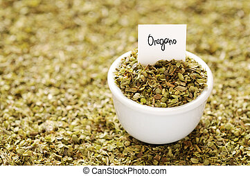 Oregano - Dried oregano in a white ceramic bowl