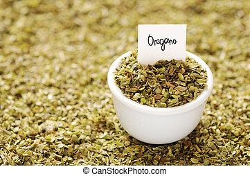 Oregano - Dried oregano in a white ceramic bowl