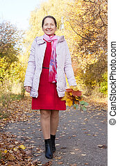 mature woman  in autumn park