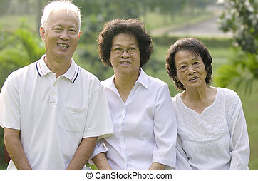 Three Senior Asian Smiling happily at park in a morning