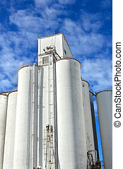 Grain storage - Grain elevator is icon in the small...