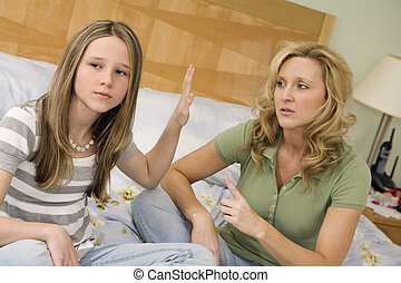 Mother and daughter - Caucasian mother and preteen daughter...