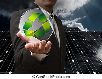 recycle energy - business man hand shows recycle glass...