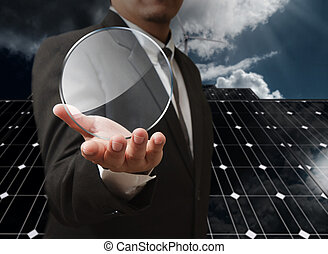 energy saving - business man hand shows blank glass shield...