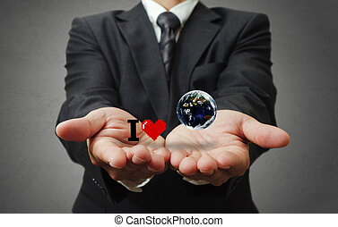 I love the earth as concept - business man hand holds I love...