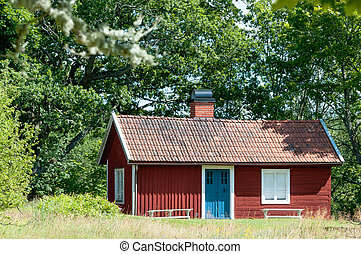 Quaint traditional red Swedish cottage