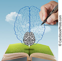hand drawn pixel brain as concept - open book of hand drawn...