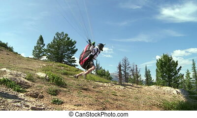 Paraglider launching 06 - Paragliding high above the...