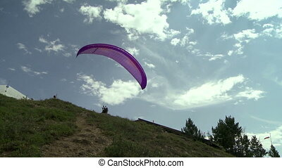 Paraglider launching 07 - Paragliding high above the...