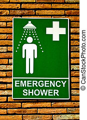 The Sign emergency safety shower on wall background - The...