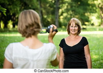 Woman is taking video of her mother