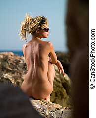 nude woman on the sea_04 - naked girl sitting on the rocks...