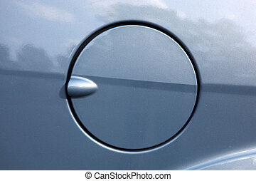 A close up of a petrol cap cover on a modern car