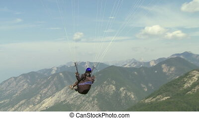 Paraglider launching 05 - Paragliding high above the...