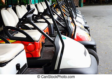 Golf carts on a parking lot