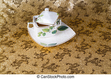 green tea set with a background