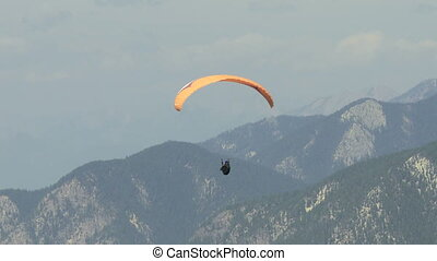 Paraglider with windsock - Paragliding high above the...