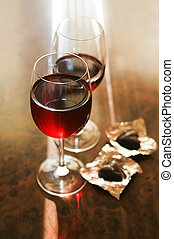 red wine - Two glasses of red wine and two chocolates
