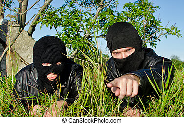 Two criminals getting ready for offense