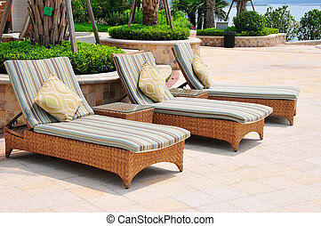 chaise longue - Picture of three chaise longues beside...