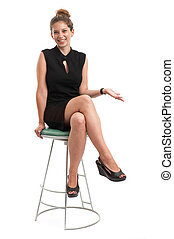 young woman sitting on a chair isolated over white...