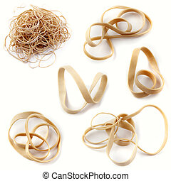 Rubber bands on plain background
