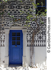 striking blue doorway in greece