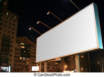 Billboard in night city - big rectangular billboard in the...