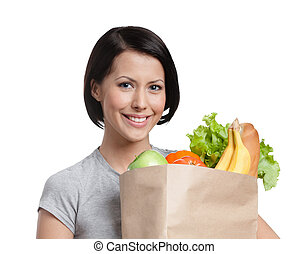 Smiley girl keeps the packet of vegetables, isolated, white...
