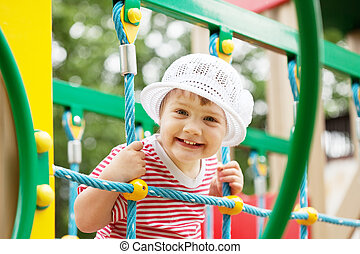 Happy two-year child in playground area - Happy two-year...