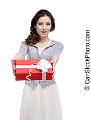 Young woman hands a gift wrapped in red paper, isolated on...