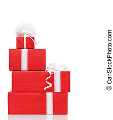 Pillar of boxes with presents wrapped in red paper, isolated...