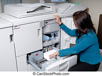 Photocopier Machine - Woman Loading Paper Into A Tray Of A...
