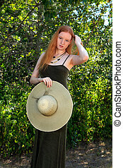 Outdoor Portrait - Young Woman With Red Hair Wearing A...
